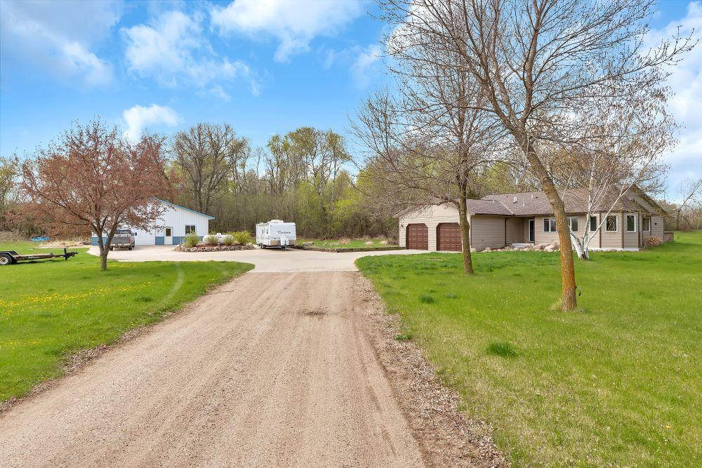 Looking for one level living in the country with acreage? Enjoy this 2 bedroom/ 2 bath patio home with 16.37 Acres. This open concept home features a large foyer, kitchen with eat in breakfast area, stainless steel appliances, walk in pantry. Living room, full master with walk in closet & full bath, one bedroom could be easily converted into a 3rd bedroom, full bath, family room with gas fireplace & sunroom, laundry & utility room off of the garage. Lots of yard space, exposed aggregate patio with great entertaining space. Apple trees.  40x50 pole shed with 220 amp, concrete flooring, 10'sidewalls 9'doors. You will not be disappointed to what this property has to offer!