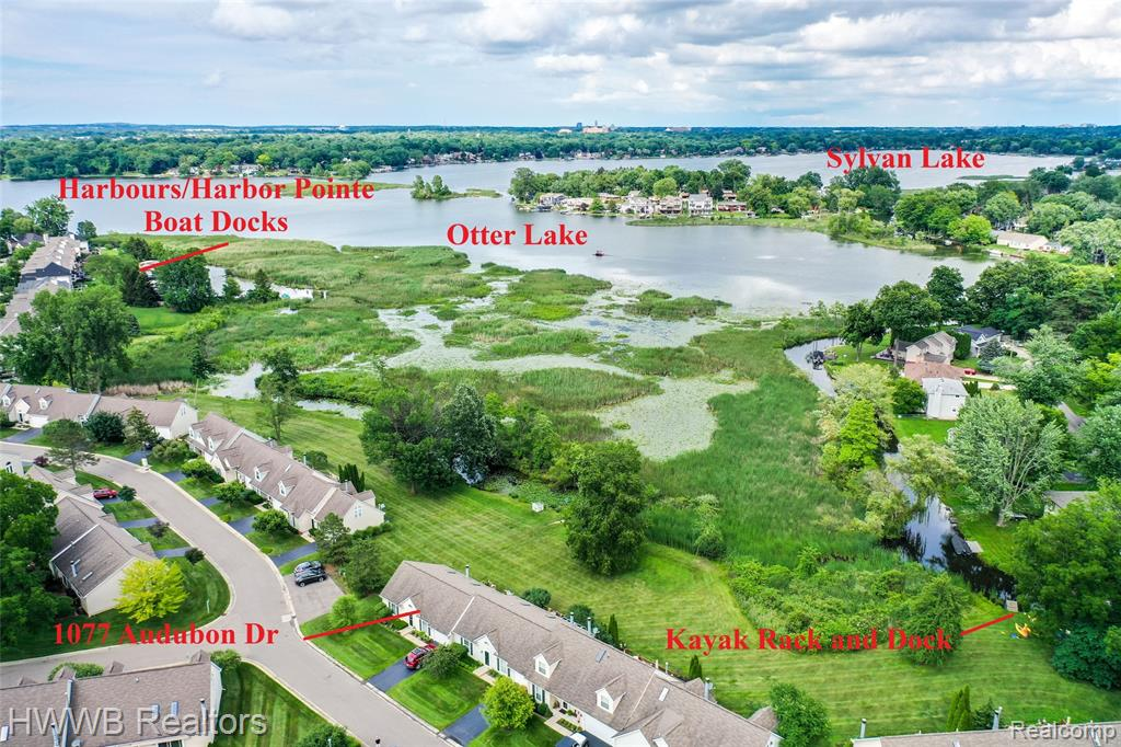 You can find it all - perfect blend of superb condition, features & an ideal lakefront setting. End unit with beautiful views of nature, a broad sweep of lawn to the water's edge & a short stroll to kayak storage & you are off to Otter and Sylvan Lakes. Newly remodeled bright kitchen with custom Shaker style cabinets, granite, stainless appliances & a breakfast nook. Kitchen view to cathedral Great Room, with delightful fireplace & mantle, skylight, dining area & doorwall to deck. Many updates including new furnace & humidifier, windows, lights, ceiling fans, decor, water softener, fixtures & more. Wonderful Master Bedroom retreat with cathedral ceiling, skylight, window view to lake, walk-in closet with custom organizer, & private master bath. Spacious 2nd Bedroom with walk-in closet & access to 2nd full bath. Deep attached garage, entry foyer with room for furnishings & the list goes on. Very well maintained Harbours complex - you will love the lifestyle this home provides.