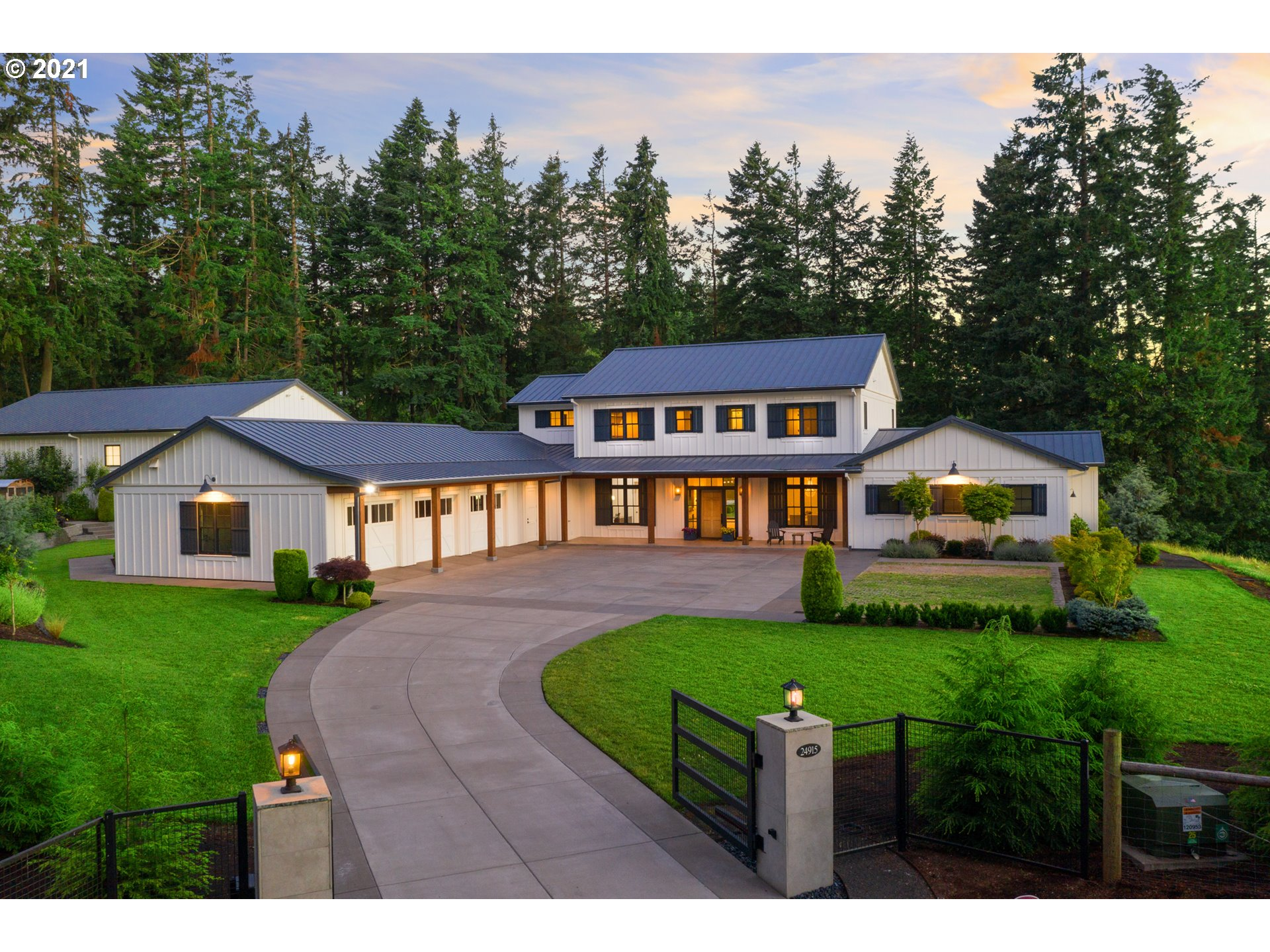 Stunning custom home situated on 6.2 acres in the heart of Pete's Mtn. Built with no details left untouched. Great room floor plan with walls of windows and high ceilings throughout. The gourmet kitchen is open and airy. Primary bedroom suite + 2nd suite on main. This home is perfect for all lifestyles! Lg game rm, office, private gym & sauna PLUS a 2000sf connected custom basketball ct w/soundproofing. Entertaining outdoor space w/sparkling pool,manicured lawns,garden beds & views. Gated entry.