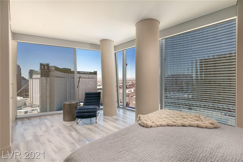 """Designer fully furnished corner unit located in the heart of CityCenter. This stunning unit includes automated shades, lighting and an 85"""" Sony 4K TV! Walking Distance to the T-Mobile Arena, fine dining, shopping, broadway caliber entertainment, art galleries, & More! Building features include: valet parking, rooftop pool, concierge, 24-hour security, gym, conference room, library & billiards room! SEE IT ALL from this freshly renovated hard to find corner unit with 8 floor to ceiling windows: Aria New Years Eve and July 4th direct FIREWORKS view.  New York / New York, Park MGM, The Aria, Luxor Pyramid, Stature of Liberty, The New York Roller Coaster, Airport  & Helicopter Site Seeing Traffic views.  Privacy Blinds, Blackout Blinds, New Floors, New Paint etc.   This unit comes fully furnished, Immaculate and ready to move in. Come live in the heart of the city center."""