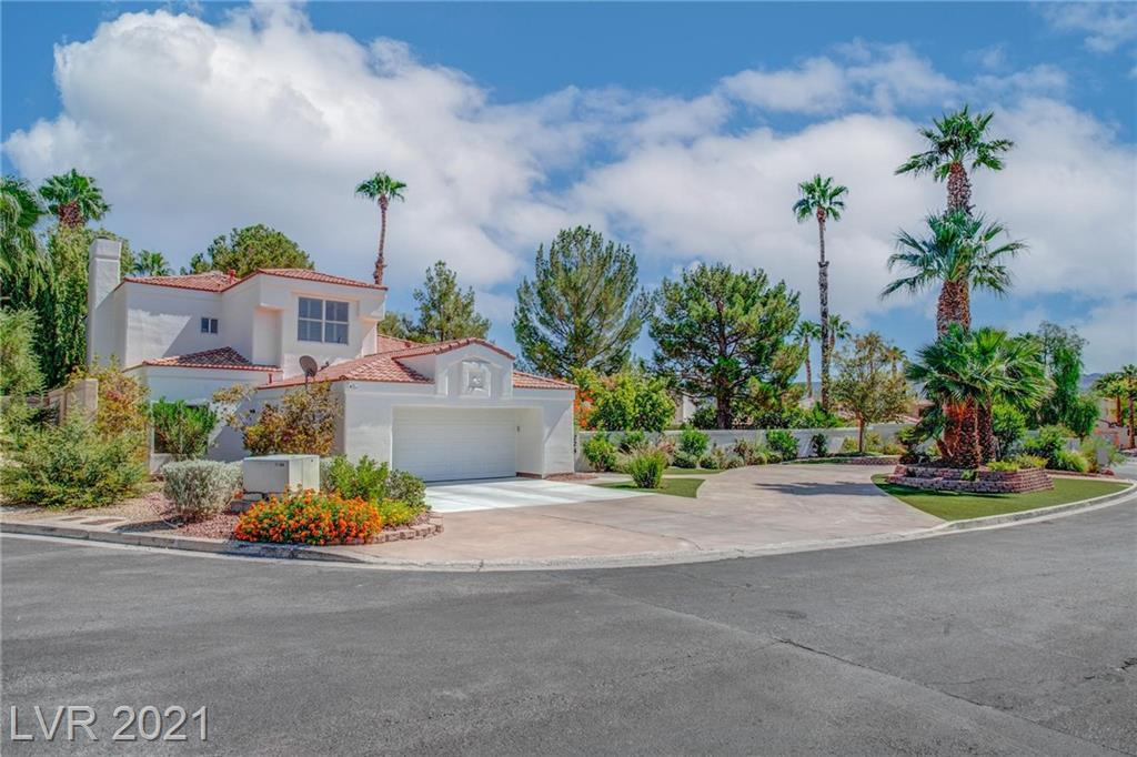 UNIQUE GEN IN THE HEART OF GREEN VALLEY! - 15,000+ sq ft lot in a gated community with one of a kind, grande circular driveway surrounded by mature, luscious landscape, which include many different fruit trees (cherry, apples, apricots, nectarines, lemons, pear & fig). Spacious living room with vaulted ceiling, large family room with wet bar area, perfect home for entertaining.  Home includes 3 fireplaces, of the 3, 2 are two-way fireplaces.  The kitchen has stainless steel Bosch appliances & a wine fridge, including a beautiful new of the resort style backyard through a garden window.  Built-in propane BBQ, built-in beer tap, wine fridge, huge diving pool with spa, custom enclosed outdoor shower, unground trampoline, retractable awning, all surrounded by lush landscaping, truly one of a kind! MUST SEE!