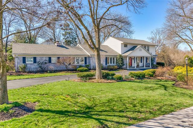 You will love this pristine house!  From the moment you enter the home you will be enamored by the sweeping staircase and openness. The living room has a fireplace and is bright with an expansive picture window. The dining room opens to the living space and has sliding French doors that lead to a charming outdoor entertainment area with a gazebo. The kitchen features birds-eye maple cabinets, granite counters and a gas range. Off of the kitchen is a den with a fireplace. The master bedroom suite encompasses the entire 2nd floor with built-in office area, 2 walk-in closets and a master bath featuring dual sinks, jacuzzi tub & separate shower. The main level has 3 bedrooms, 2 full baths, plantation shutters and oak. The lower level provides great recreation space with family room, wet bar, gym area, full bath, tons of storage and a walk-out to a patio featuring a waterfall. 2-car garage.