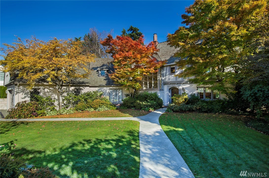Magnificent, extensively updated 1928 Tudor Revival. Brick walls w/stucco & timber detailing; shake roof; leaded glass windows. Elegant interiors w/ hardwood floors & crown molding. Living room w/ fireplace, sitting area & sunroom w/ access to expansive terrace & back lawn. Dining room & 2016 kitchen have terrace access as well; inviting family room; fabulous master suite w/fireplace; office; gym; wine cellar; 3rd floor has additional 2 bedrooms; attached 2-car garage.