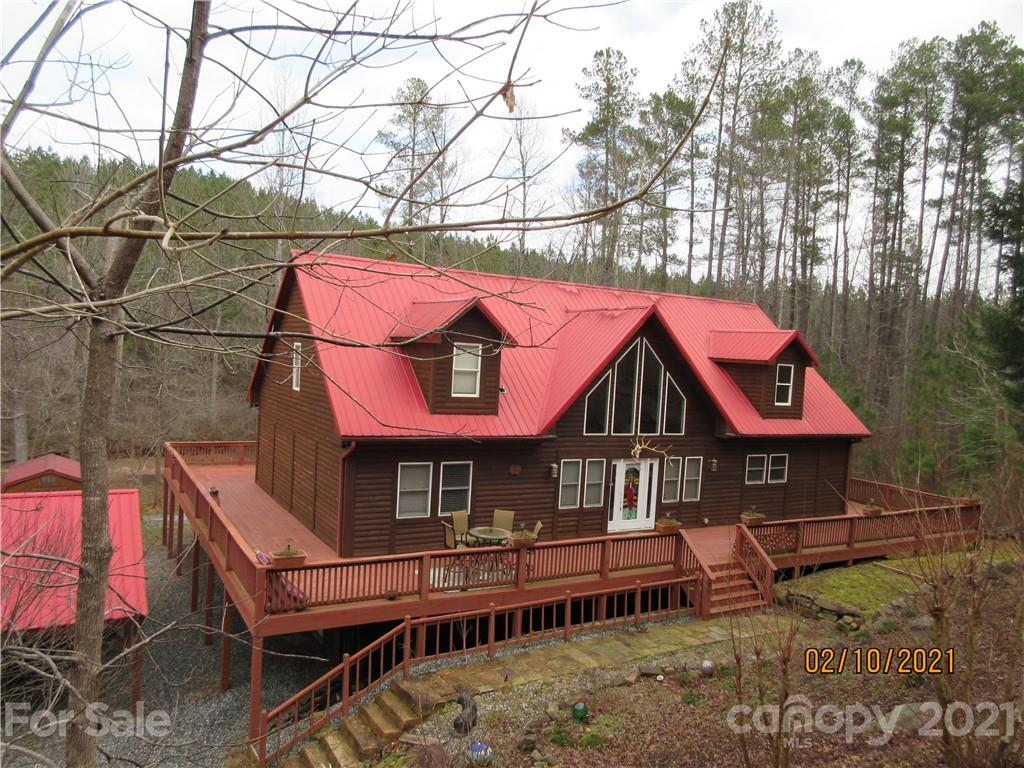 Custom built log home in gated community.  This beautiful cabin is perfect for year round or vacation home with 3 bedrooms/2.5 baths,  large open living area with rock fireplace with gas logs, deck wraps all the way around cabin, above ground pool, and basement is one big man cave with den area including rock fireplace with gas logs,  bar, and billiards, creek runs along back of property.  Peaceful country setting only minutes from downtown Rutherfordton, 30 minutes to Lake Lure/Chimney Rock area, and 1 hour to Asheville or Charlotte.
