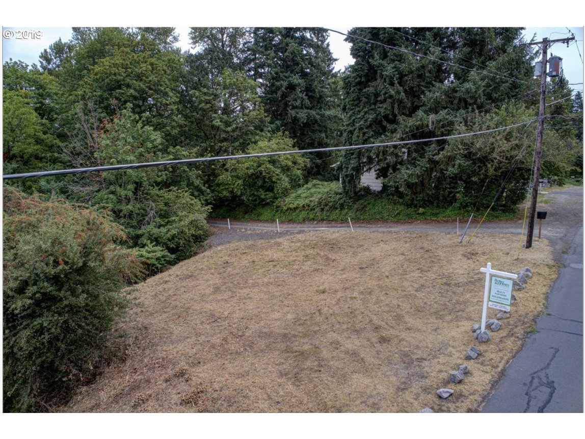 Be the first in Oregon City to take advantage of new zoning that allows corner lot duplex. Front of the lot is level and becomes sloped. Check with the City of Oregon City Planning for requirements to build on this property.