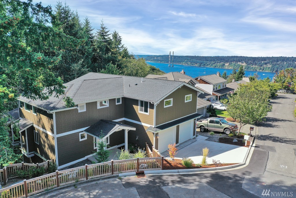 WOW! Custom N.Tacoma Sound & Bridge View Home! Great Rm w/Soaring Ceilings, Gas FP, Xtra Large Slider to View Deck w/Gas FP+BBQ hookup. Elegant Kitchen w/Custom Cabinetry, Granite Counters, SS Appliances, Oversized Island, W-I Pantry, Nook & Dining Rm.  Huge Upper Master Suite w/Vaulted Ceilings, 5pc En Suite Bath + 2 W-I Closets. Bright Loft overlooking Great Rm. 2 Beds share Full Bath. Main Floor Jr Master. Lower Level Fam Rm. Vac System/Tankless Hot Water. Close to Parks, Ruston, Pt Defiance.