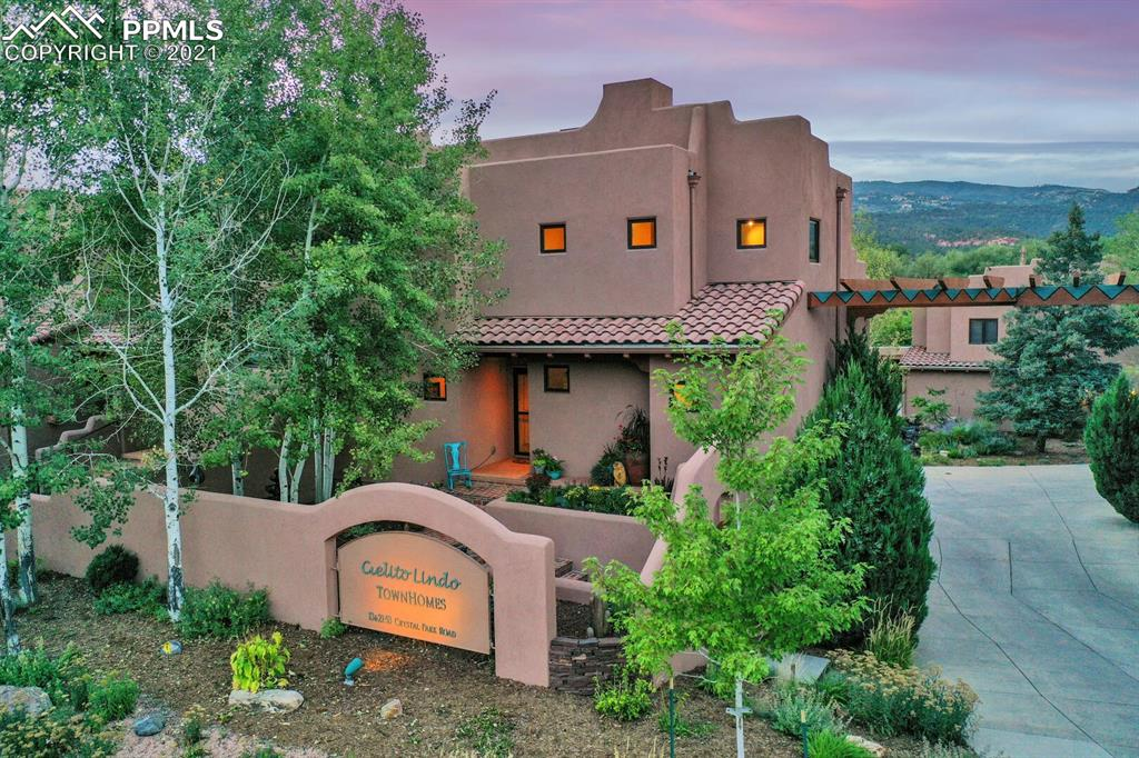Incredible townhome!!  Don't miss this rare opportunity to live the good life in an easy care townhome, on the outskirts of one of the most intriguing towns in Southern Colorado.  This home was built to maximize the gorgeous setting and relaxing outdoor living spaces.  The townhome is in a quiet community with views of the mountains and Garden Of The Gods.  Rooftop deck for enjoying the beauty of Colorado, complete with gas grill, hot tub, and dumbwaiter!  You'll be grateful for the three car garage.  Don't miss the bonus room on the garage level.  Go up one level to the master bedroom, kitchen and laundry room, and up one more level which has two more bedrooms and a bath, and an additional living area.  Access the rooftop deck from this level.  Gorgeous high end finishes, upgraded kitchen countertops and backsplash, shining floors, kiva-style fireplace, pantry, the list goes on and on. This townhome is in great condition and clean clean clean.  Move right in and enjoy the good life!  Don't miss out on this stunner.