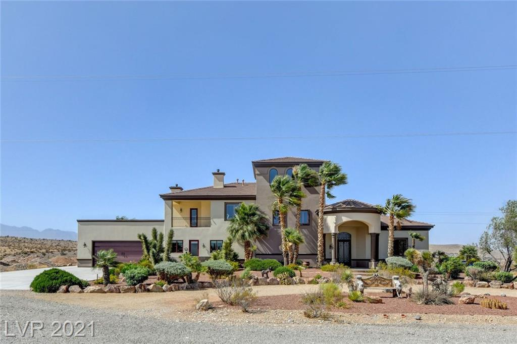 """SECLUDED CUSTOM BUILT ESTATE SPANNING OVER 2 ACRES just minutes from Red Rock Canyon has 5 BR + 7 BA + office + game room + casita + private well. Plenty of room for horses, vehicles, toys, RV parking. Property is surrounded by endless off-road trails, nature, hiking, biking. """"Hidden"""" loft/ attic/ cave/ den not included in total SF offering 360 degree views. Property Features include: Polar Ply radiant barrier, 2X6 construction, central vacuum, 5 total AC units, 3 laundry rooms, whole house surround wired, cherry wood floors, 10' ceilings downstairs, 9' ceilings upstairs, 8' solid alder wood doors, wood shutters, crown molding, game room, storage sheds. Casita / guest house w/ separate laundry room, 2 bedrooms and 2 full baths. Entire 2nd floor is master suite with coffee room, retreat, 2 over-sized terraces offer mountain & strip views,  master walk-in closet has custom built-ins and W/D. Kitchen Features Thermador appliances, warming drawer, prep sink and """"hidden"""" walk -in pantry."""