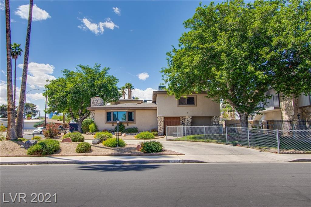 This large home on large corner lot in desirable LV neighborhood deserves your tour and consideration. Convenient and only minutes from local amenities. Close to downtown and strip, shopping too!  Ample room on main house and Casita to accommodate extended family and kids. Outdoor activities a must with covered patio, pool w/slide and diving board and built-in BBQ. Circle drive is inviting after a long day at work or just a run to the store. Atrium window and fountain lend to calming atmosphere.