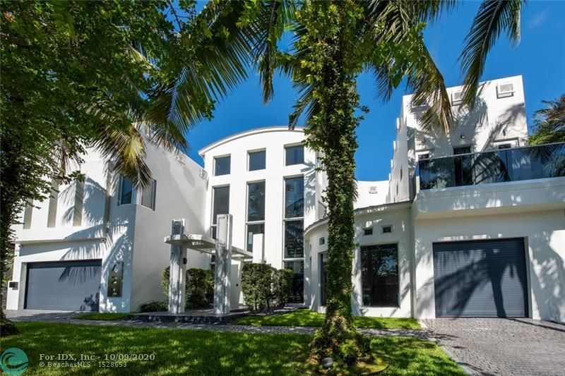 """""""GLASS HOUSE"""" PRIME 3 STORY SOUTH LAS OLAS ZEN CONTEMPORARY JUST OFF THE NEW RIVER! 5 MINUTES WALK TO DOWNTOWN LAS OLAS BLVD! 80 FEET OF DEEP WATER DOCKAGE JUST 5-10 MINUTES TO PORT EVERGLADES! NICE VIEWS OF THE NEW RIVER FROM THE GRAND TROPICAL BACKYARD! THREE STORY 35' HIGH GRAND FOYER WITH DRAMATIC GLASS ELEVATOR! 7 BEDROOMS 6 FULL BATHROOMS 3 HALF BATHS, 3 CAR GARAGE, HEATED SALT WATER POOL!HOME THEATER ON THIRD FLOOR! 7,750 SQUARE FEET GROSS. CGI TOP OF THE LINE WINDOWS! NEW PORCELAIN FLOORS! GRAND SOUTH FLORIDA ENTERTAINING AWAITS! BEST VALUE IN SOUTH EAST FORT LAUDERDALE WATERFRONT FOR A LARGE CONTEMPORARY PROPERTY!"""