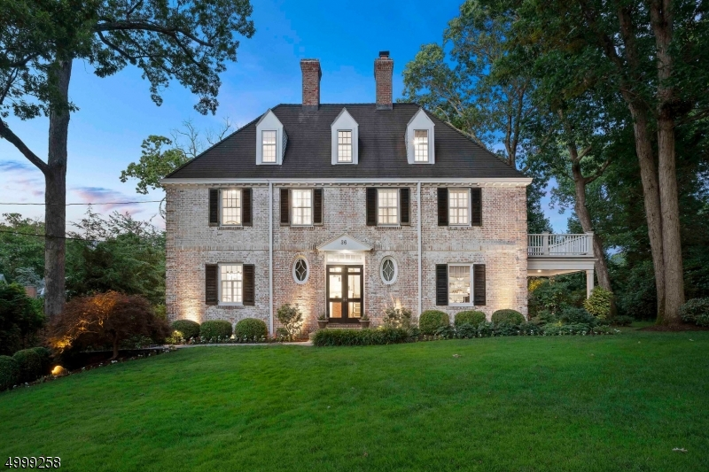Iconic Summit Brick Center Hall Colonial! This 6 bedroom, 3 full, 3 half bath home has a great open floor plan that flows outside to your private oasis. You are welcomed to this home from the street with it's unparalleled curb appeal. As you enter you have a large front to back living room with a wood burning fireplace. There is also a dining room, breakfast room, kitchen with a center island that opens to a family room with gas fireplace and mudroom. The second floor has 4 beds and 2 baths, with the third floor having 2 bedrooms and 1 bath. The basement is finished and has a 3 car garage in the lower level. The backyard has a patio, covered porch, and very private yard for entertaining. This truly is a must see.