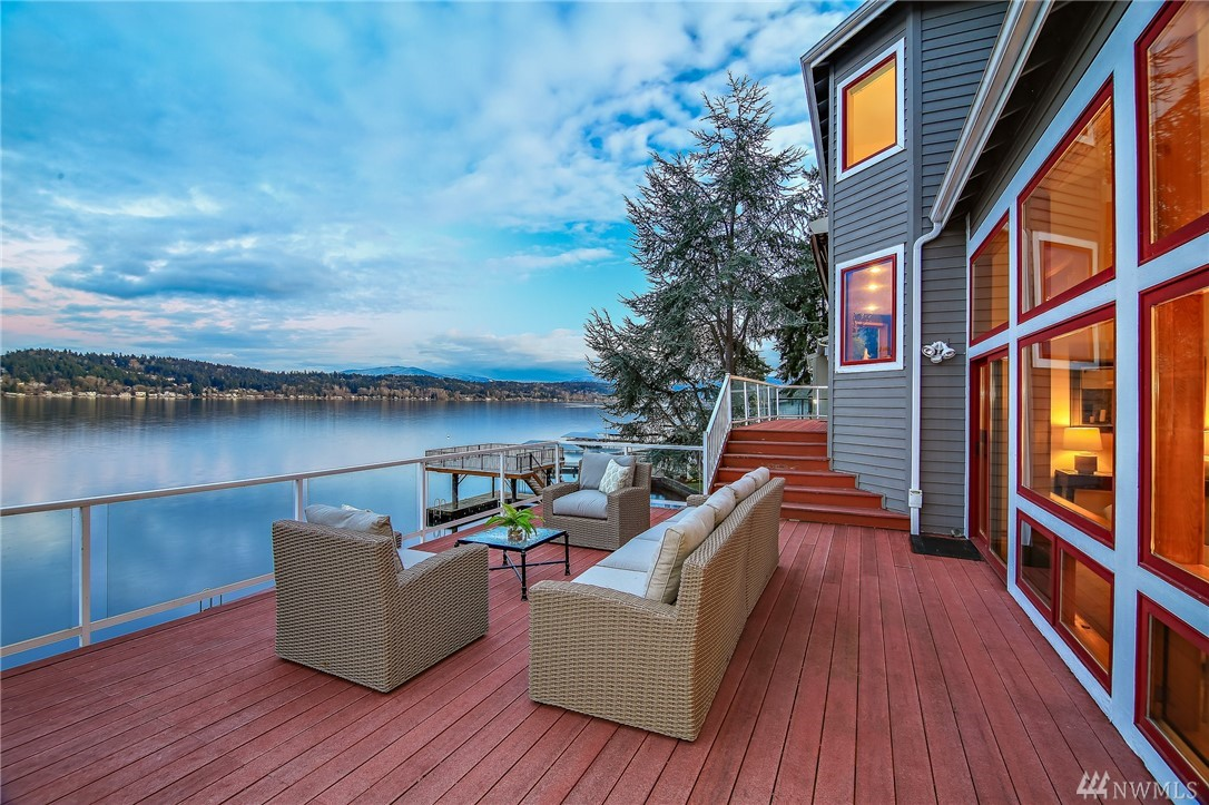 Positioned on the water's edge, enjoy all that lake living has to offer! This Iconic NW contemporary has soaring walls of windows allowing the sun to stream in while you watch all the activity on the lake.  Mountain views as well! Nestled in sought-after Mallard lane on 105 ft of waterfront.  The three levels have been tastefully updated and feature a cook's kitchen w/a large island, granite counters, custom cabinetry and stainless appliances.  Three entertaining decks, a hot tub & large dock.