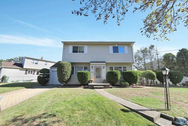 Spacious Colonial tucked away in residential Allwood section near Nutley border. Main level offers formal living room open to full size formal dining room perfect for entertaining; Eat-in-Kitchen w side access to patio, den/office w built-ins and full bath. 2nd level offers oversize master bedroom, 3 additional bedrooms and 2nd Full Bath. Finished bsm't w sizeable Rec Rm for additional living space, 3rd Full Bathroom, Prep area w cabinets, and outside access. Pull down stairs to attic for extra storage area. Most windows replaced; Multi Zone gas heat; Central AC and extra split unit; Yard with storage shed; Paver driveway leads to attached Garg and more. Near public Transp, shops and highways. A MUST SEE!