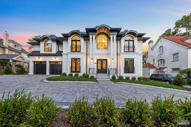 9000 Sq ft Luxury designer smarthome w 4 level elevator, 3 car heated garage, theatre, gym, and gorgeous finishes throughout..   This is the best build in the best location. The VIRTUAL TOUR link for this listing contains an enormous amount of relevant information including a comprehensive video tour with hidden features & room dimensions, written description, additional photos, floor plans, and a complete interactive 3D model of the home.