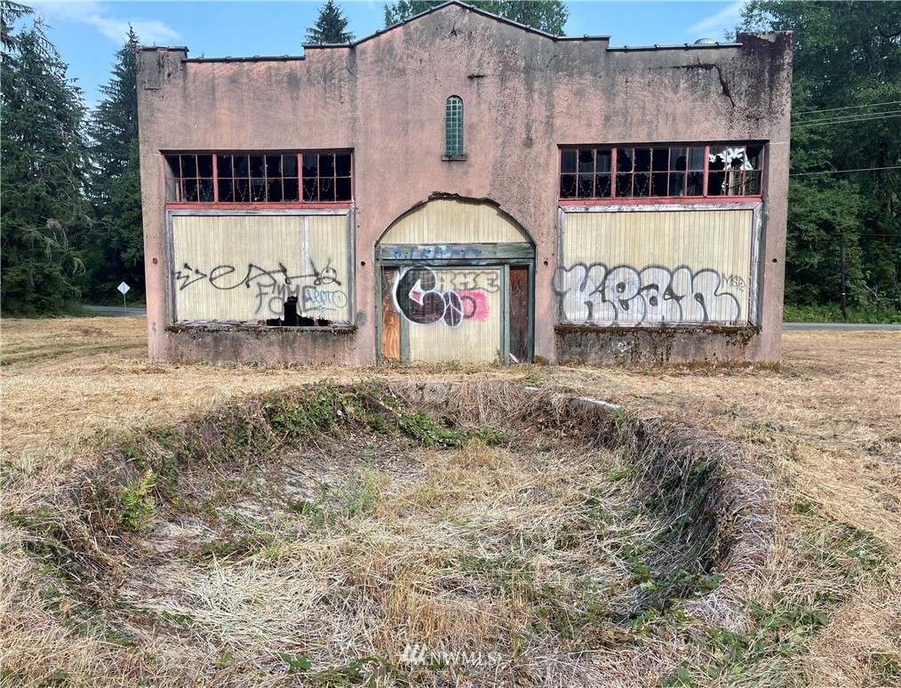 Former Power Plant on 1.85 acres w/ commercial options & 57K/Month traffic count. Reinforced concrete structure that is 1320 SF w/ 22' high ceilings, double-door entry & 2 concrete loading bays. Circa 1929; unoccupied since 1940's. Solid bldg despite broken windows & graffiti. Square footage can be nearly doubled by adding a 2nd floor. Drilled well & electric previously connected! Located at intersection of St Hwy 7 & Mineral Rd S between Elbe & Morton. Topography is flat w/ mostly cleared areas - definite room for expansion or parking. View of Mt. Rainier & close to Mineral. Prelim work completed: survey, septic design, soil, water, remodel plans & much more. Looking for the right person with the right dream & vision. Think Small business!