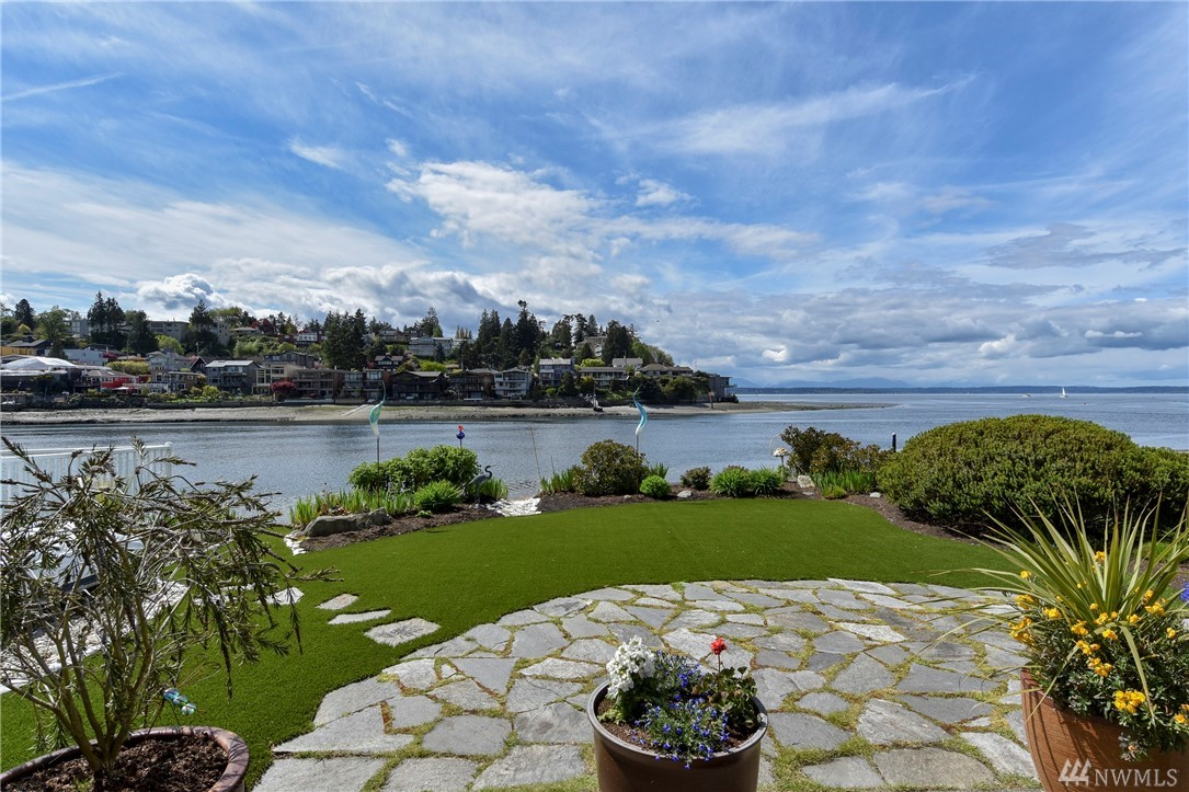 Rare opportunity to own 40 feet of low-bank waterfront in Sunset Hill.  A remodeled beauty that brings out the finest in Seattle living.  Featuring stunning views of the Sound & Olympics, this entertainer's masterpiece has everything to offer.  Private quarters are luxuriously appointed, including the master suite with a spa-like bathroom. Indoor & outdoor living mingle seamlessly. Perfectly located amidst the B-G Trail, Ray's, Golden Gardens and so much more.  A truly spectacular dwelling.