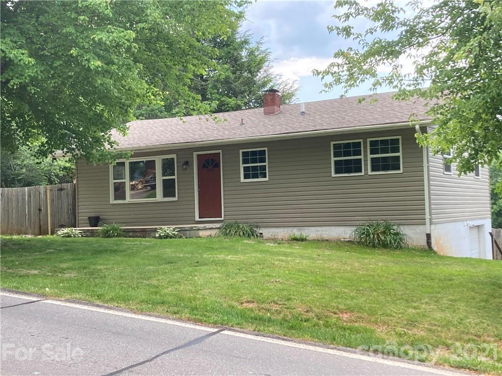 Multiple offers received. Sellers requesting highest and best by 5pm on 6/8. Great starter home located just outside of downtown Waynesville!  Freshly remodeled bathroom with tile floors and tile shower surround.  Updated windows and HVAC in 2014. Eat in Kitchen with indoor and outdoor basement access.  Fairly level and fenced in corner lot with deck for outdoor people and pet activities!