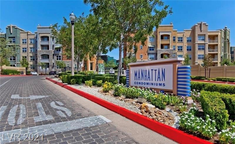 Located just minutes from **Raider Stadium** just off of South Las Vegas Blvd. This beautiful Manhattan Mid-Rise, GUARD GATED condo offers many amenities. This residence is located on the 3rd floor (elevator access) with a balcony that has South Las Vegas Blvd & mountain views. You can see the South Point and M Resort from balcony.  This popular **corner unit** 2 bedroom & 2 full bathroom midtown floor plan with designated **underground garage parking** is waiting for you to make it a home, second home, or vacation property. All appliances & existing furniture including kitchenware, dining table, & sofa, etc are included, too! The community boasts a large grassy **Central Park**, has a state of the art **fitness center, media room, business center and more.**  The Manhattan's are located minutes from the heartbeat of the famous Las Vegas strip, dining, outlet shopping and I-15 & I-215 freeway access. THIS IS THE PLACE TO BE!!  Don't wait to make this property your own.