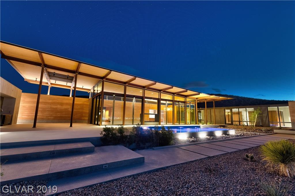 A harmonious integration of Ascaya's natural essence & exquisite landscape into an emotive/elegant architectural design. Lake Flato designed home showcases a delicate balance of durability & elegance w/Rammed Earth walls & floor to ceiling glass windows. Sustainably built walls absorb sunlight & release heat at night, while extraordinary windows frame panoramic strip/mountain views. Drift into your dreams as you gaze over a sparkling Vegas Strip.