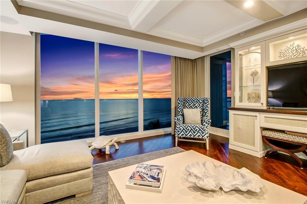 Breathtaking views await from this highly sought after and rarely available Panorama unit. Ideally positioned on the Northwest corner of Moraya Bay, floor to ceiling windows frame the beautiful curves and sparkling lights along the coast to Sanibel. Purchased from the builder in 2014, the decorator ready buildout was designed by Barbara Greco of Barbara Hyman Interiors.  The elegant, coastal design has extensive built-ins and upgrades that blend tech and style seamlessly, including a designated guest wing with study area & re-imagined ADA compliant master bath with Gulf views and custom owner's closet. Each unit enjoys a private lobby entrance from the elevator and impressive views from every window. Entertaining is made easy with a chef's kitchen, featuring Monogram appliances and butlers pantry. Moraya Bay is an amenity rich and pet-friendly building directly on Vanderbilt Beach and features Five-Star luxuries such as: Access to The Floridian Beach Club and Kalea Bay, gated entry and attended lobby, 2 resort pools, chair and towel service, private restaurant with pool and beachside service, impressive fitness center, concierge, and 24/7 security. *3D TOUR AVAILABLE*