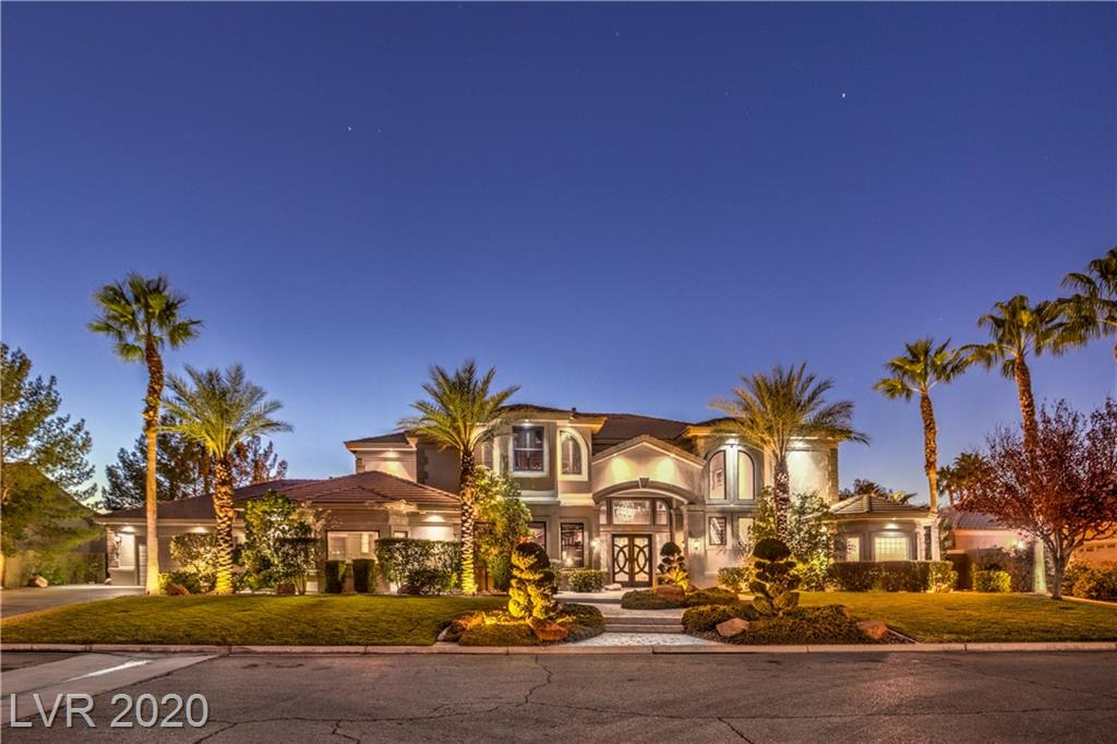 One of a kind Section 10 Stunner!! Completely custom residence with over 1.5 million in recent upgrades. Custom millwork, travertine floors, wrought iron staircase, suede and Japanese silk wall finishes along with unique designer light fixtures. The floor plan is currently set up to accommodate a music industry professional with a full recording studio and a number of other sound dampening rooms. The downstairs master is located next to a home gym and on the same floor as the wine, scotch and cigar den. The entire complex is made for entertaining featuring a guest suite, in home theatre, loft adjoining the custom wet bar & spacious outdoor balcony overlooking the extra large 60 foot long, 10 foot deep pool. The outdoor area is made complete with backyard patio furniture worthy of a strip resort, a 12 person spa, built in BBQ, outdoor TV and additional bar top seating.  Two separate 2 car garages with an oversized driveway ensure that all visiting guests will have the necessary space.