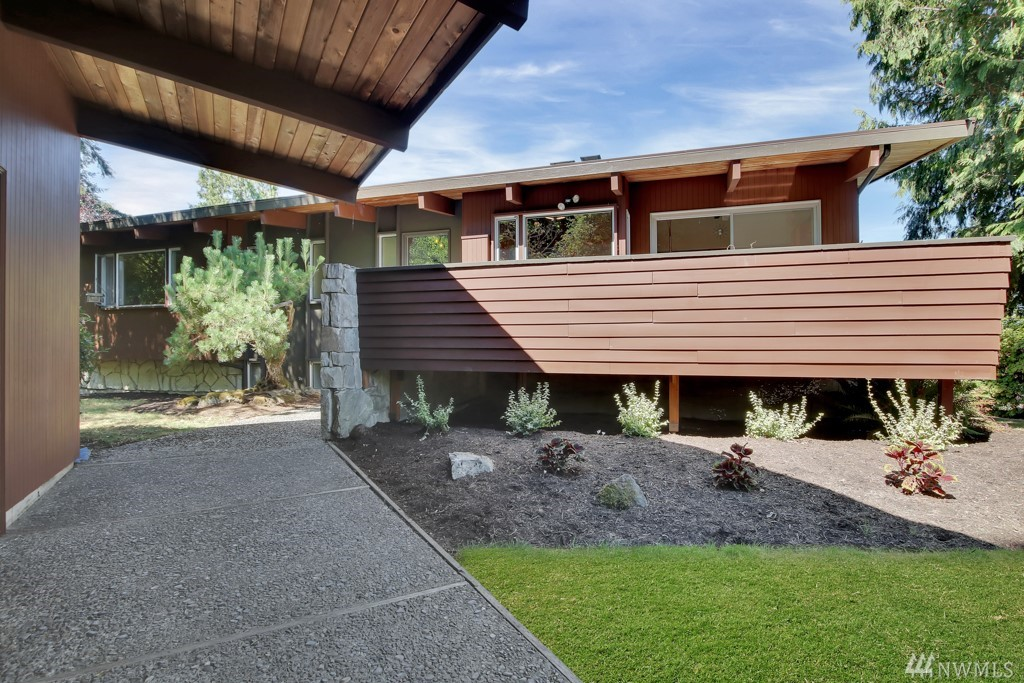 Welcome home to this PNW midcentury modern gem.  5 large bedrooms, 3 bathrooms, an updated kitchen with granite countertops, stainless steel appliances, dining/living area great for entertaining and deck space to hold all those gatherings while you enjoy an expansive view of Puget Sound are just a few of the things this home has to offer!  Just over 3/4 of an acre yard backs up to a green belt.  You wont want to pass up this gorgeous opportunity in the coveted Marine Hills neighborhood.