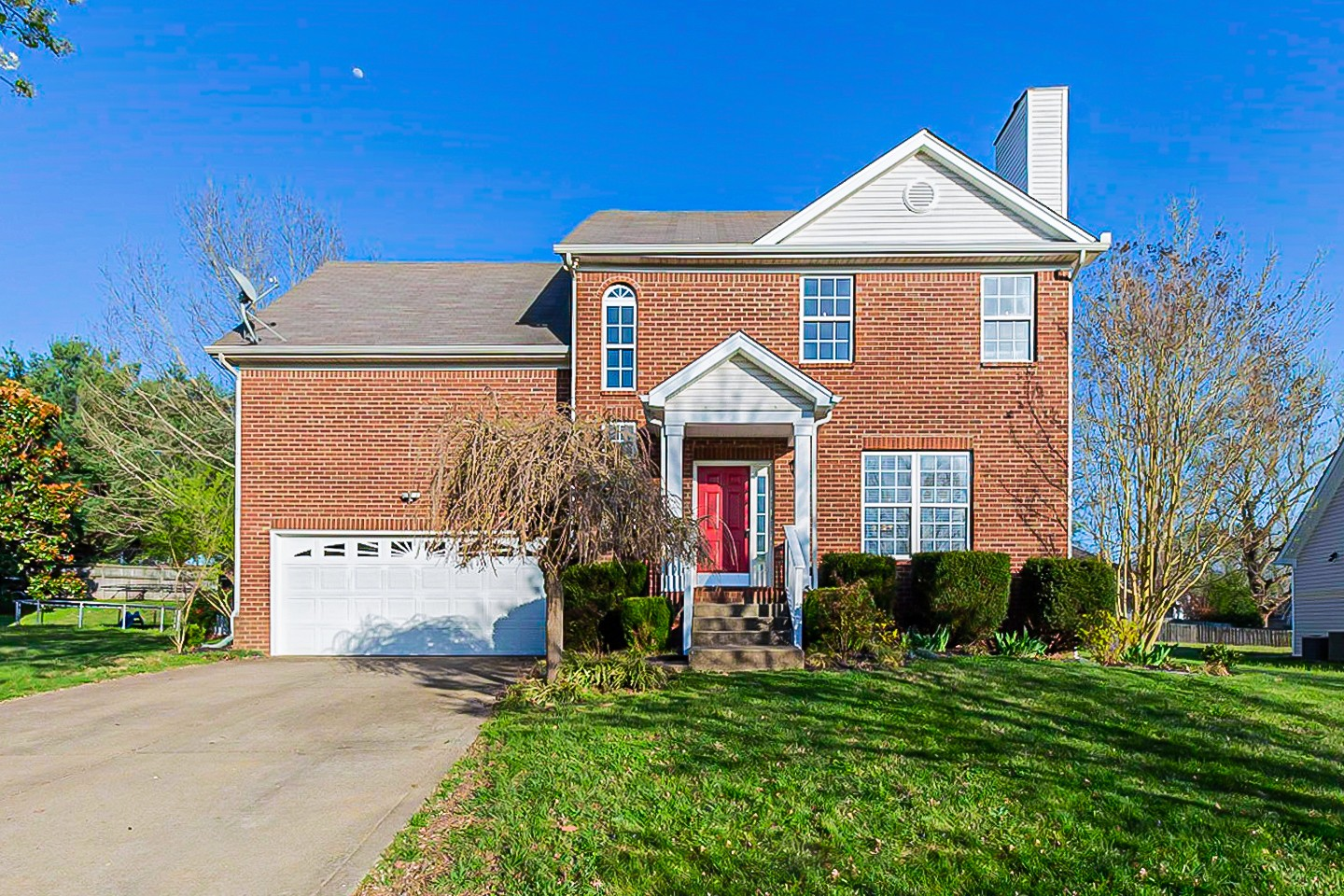 This Spring Hill two-story home offers a two-car garage.
