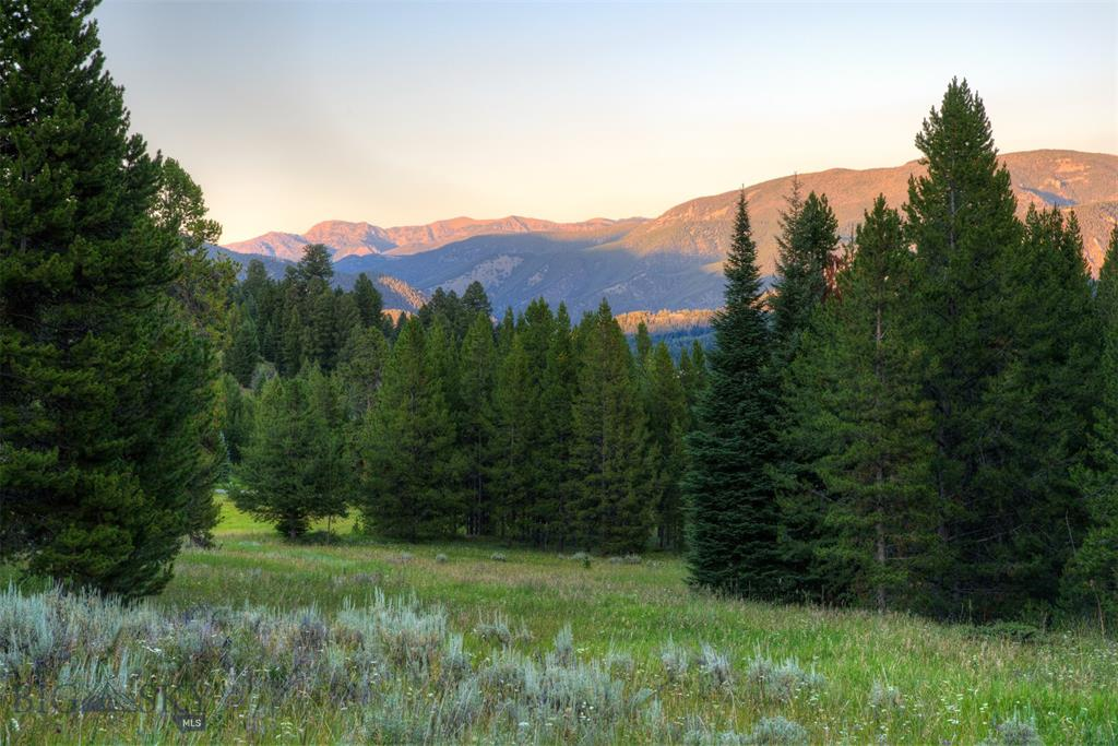 Ranch lot 6 is 2.2 Acres with old-growth trees and view of the Gallatin Range and a short drive to Big Sky Town Center and Spanish Peaks' Member Clubhouse. Spanish Peaks Mountain Club is highlighted by a Tom Weiskopf 18 hole championship golf course with an adjacent clubhouse. Members also enjoy private access via the clubhouse to world-class skiing at Big Sky Resort dining, bar, workout facility, pro shop, men's and women's locker rooms with private access to the pool and hot tubs. A golf or ski social membership is available for purchase with this property.