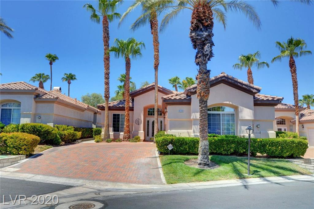 BEST OF CLASS IN RESORT VILLAS! GOLF COURSE FRONTAGE ON 5TH HOLE OF WILD HORSE GOLF CLUB. ONE OF LARGEST LOTS IN THE COMMUNITY!  PAVERS DRIVEWAY, UPGRADED TRAVERTINE FLOORING; GRANITE COUNTER-TOPS IN KITCHEN WITH DOUBLE OVEN; PANTRY CABINET; STAINLESS DISHWASHER; WATER FILTER; DESIGNER HARDWARE ON CABINETS; DINING NOOK; LARGE LIVING ROOM W/ HIGH CEILINGS FOR AN OPEN FEELING; MASTER SUITE IS SEPARATE FROM OTHER BEDROOMS; DUAL VANITY; SEPARATE TUB & SHOWER; WALK IN CLOSET; UPGRADED CRYSTAL FANS & LIGHT FIXTURES; BONUS SUN ROOM OFF KITCHEN; PROFESSIONAL LANDSCAPED BACK-YARD FEATURING TOTALLY PAVERED W/ ACCENT SHRUBS AND OASIS DATE PALMS; GOLF COURSE PRIVACY; LARGE WEATHER RESISTANT STORAGE SHED; RETRACTABLE PATIO AWNING WITH WIND SENSOR; PAINTED EPOXY GARAGE FLOOR AND GARAGE STORAGE CABINETS; COMMUNITY CENTER WITH UNIQUE POOL, IN GROUND SPA, SAUNA; OUTDOOR BBQ & PICNIC AREA; CLUBHOUSE, WORK OUT GYM AND GUARD GATED. CENTRALLY LOCATED IN GREEN VALLEY CLOSE TO ALL AMENITIES. A MUST SEE!