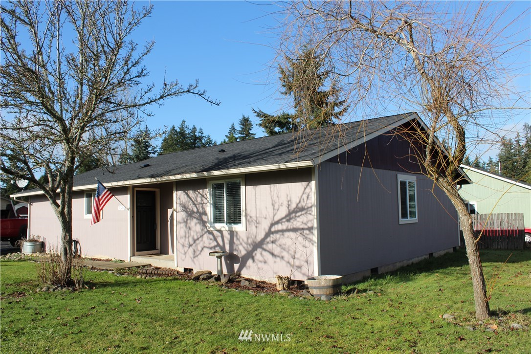 Beautifully updated 4 bed 2 bath home on large corner lot in a highly desirable area. Located just a few minutes from I-5, this 1 story rambler has access to high speed Internet for your at home office/school needs. Home also features gorgeous bamboo flooring, tiled showers, and stainless appliances. Large laundry/mud room with exterior door. From the dining room, French doors lead you outside to a spacious deck with a partially fenced yard for some privacy. Complete with a 2 year old roof and a blacktop driveway, this home is move-in ready! Oversized lot with plenty of room to build a garage/shop.