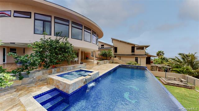 Beautifully upgraded & expanded home in quiet and peaceful Triangle/Koko Kai neighborhood. Beautiful Marina, Ocean & sunset views. Laminate wood & marble floors. Modern kitchen by Snaidero brand w/ Miele appliances. Snaidero bath cabinets. Entertain at large covered lanai and enjoy Viking BBQ grill next to large infinity pool and hot tub. Own 36 Solar-PV & 3 panel solar water heater.Great walking neighborhood. Short distance to hiking, surfing, Portlock Beach, Hanauma Bay, Koko Head crater, Sandy beach, Koko Marina shopping mall, Hawaii Kai shopping Center, great schools, library, parks, golf course, Theaters, Roy's Restaurant and life style conveniences of East Honolulu. Maunalua Bay for water sports, stand-up paddle board and boat landing. Spectacular sunsets and perfect island living await you here.
