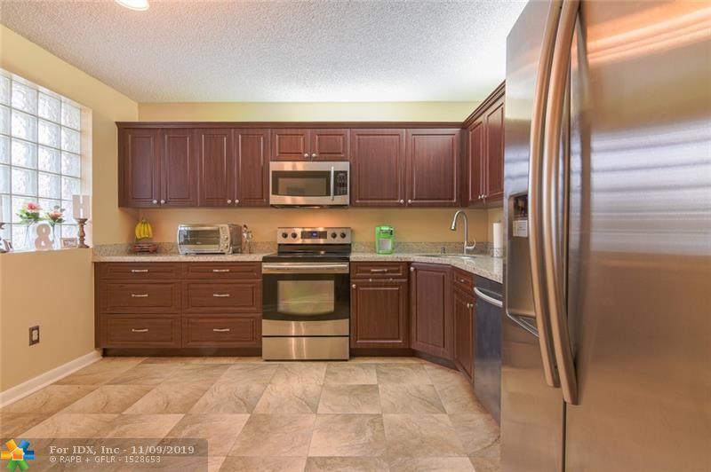 Walk into this Super Clean, Cute, Spacious, Vaulted Ceiling Condo and Feel Instantly at Home! Updated Kitchen with Granite Counters & Stainless Appliances. Tile, Vinyl and Hardwood Flooring Throughout - NO Carpet! Updated Light Fixtures. Large Screened Porch. Full Size Washer and Dryer in Air-Conditioned Utility Room. Live Your Best Life in Townships Active Community with Clubhouse, Tennis, Racquetball, Basketball, Gym, Sauna, Jacuzzi. Priced To Sell - WON'T LAST! No Pets - Leasing - Motorcycles - Trucks or RV's. Close to Highways and Walking Distance to Bus Routes - Maintenance includes: Cable TV & Wi-Fi - Water - Pool (heated in winter) - ?Trash Removal - Maintenance of common areas; landscaping, irrigation, lighting and paving - Maintenance of buildings; painting, roofs and fences.