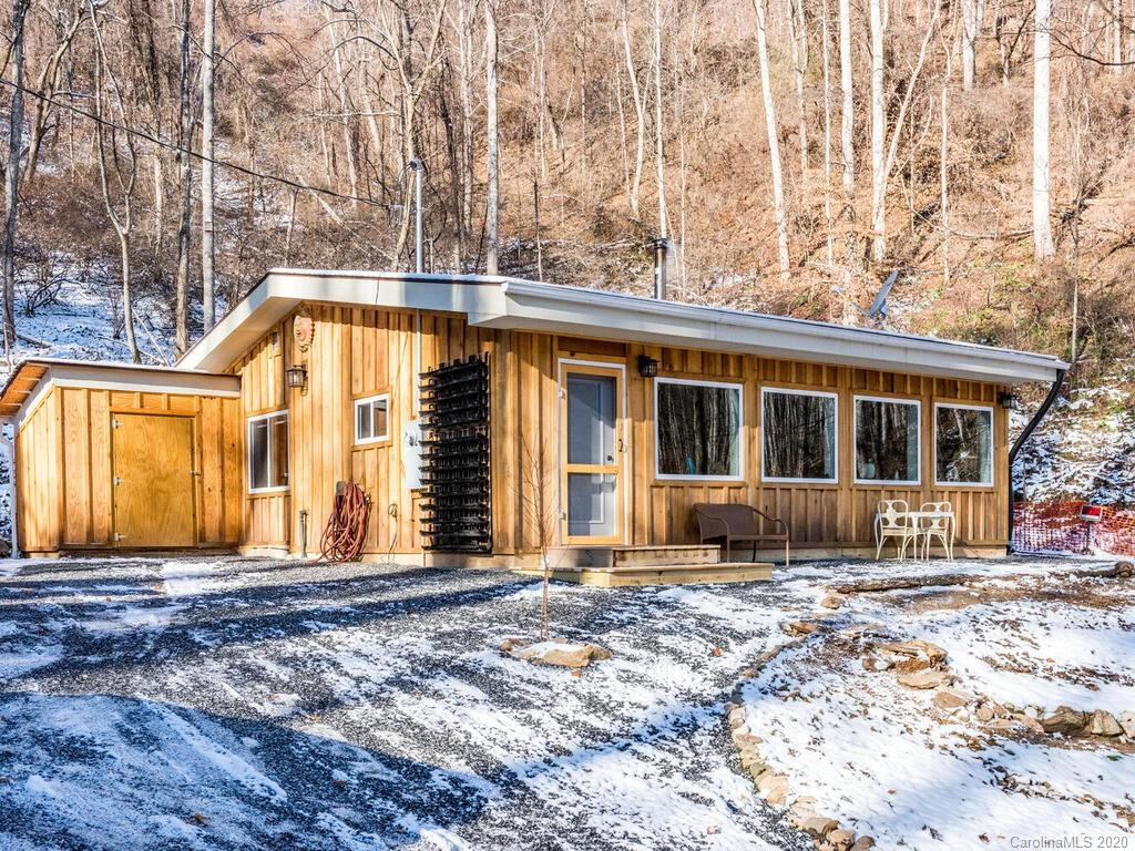 A true outdoorsman's paradise, live off the land with a chicken coop in place, a large smokehouse for smoking venison harvested on the property, season it with herbs grown in a vertical garden right by the front door, plus raised garden beds to cultivate your own vegetables. The property hosts a variety of fruit trees and berries including apricot, mulberry, cherry, apple, pear, peach, nectarine, blueberry, raspberry, and blackberries.  Flowering dogwood trees are a beautiful springtime bonus. The house has a vaulted ceiling and lots of windows to let the light in. There's a wonderful wood stove to keep you warm and toasty and a level area to have an outdoor campfire to roast marshmallows surrounded by a stacked rock wall.