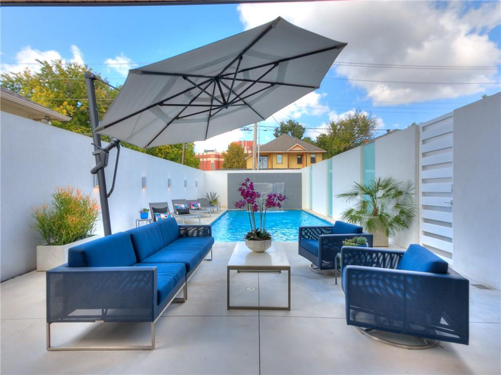 Location is key for any home but this truly is ideal for mid town living.  In SOSA surrounded by multi-million $$$ residences, this  luxury modern home is a gem!  An open floor plan that has soaring ceilings and massive windows that allow for an abundance of natural light throughout the home. Upon entry you capture the gorgeous outdoor pool w/waterfall and sun decks.  The kitchen features quartz countertops, high gloss acrylic frameless soft close cabinetry, floating vanities, Bosch/Fisher & Paykel appliances. Additional features include custom oak wood flooring, tankless hot water, geothermal, open cellulose spray foam insulation, low e double paned windows, automated custom shades and wired for a Savant home system.  There's a wrap around second level porch in addition to a rooftop deck designed to capture the best views of the downtown skyline.  The primary suite is large and has a customized walk in closet and dream bath with separate tub and shower. 3 car tandem w/custom builtins