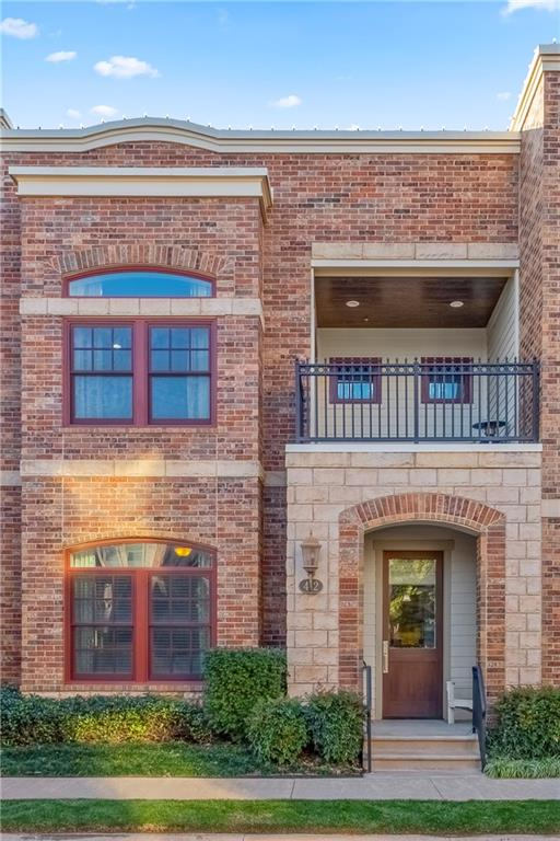Elegance and luxury abound in this absolutely stunning townhome at The Hill. Nestled in the heart of Downtown, you're just walking distance from all of the best entertainment, dining & nightlife that OKC has to offer. Zoned Geothermal HVAC, double paned wood windows, and 2'x6' exterior walls make this home very energy efficient.  An open concept floor plan is perfect for entertaining friends & family alike. Natural light & gorgeous fixtures keep the space bright & highlight the beautiful designer flooring. A spacious living room flows easily into the dining room & the stunning chef's kitchen. The stunning master suite is truly a private getaway with spa-like ensuite & custom walk-in closet. Fully equipped with attached two-car garage, storm shelter & security system, this home is as functional as it is beautiful. Enjoy resort style living with a community club house, gym, swimming pool, dog park & more just steps from your front door.