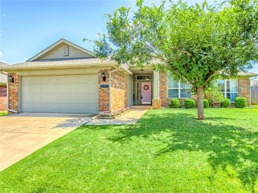 Beautiful three bedroom, 2 bathroom home in Edmond's desirable Valencia neighborhood. Located close to the neighborhood parks, walking trails and splash pads. The floor plan flows perfectly for entertaining.  Two large living areas, with a fireplace in the den.  The kitchen has plenty of storage, center island and walk in pantry.  This versatile floorplan has an option for second dining room, playroom or study.  The master bedroom is huge with large walk in closet.  Updates include newer carpet, interior paint, water heater, newer dishwasher and garbage disposal in the kitchen.   The outdoor space features a large covered patio with gas hook up for your grill and low maintenance yard.  Deer Creek schools!