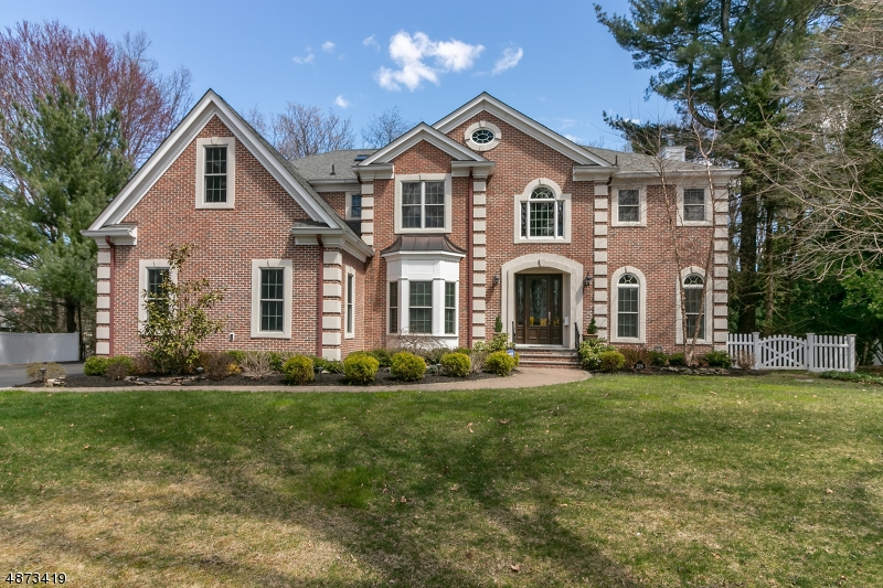 """Amazing custom Colonial on over-sized lot. High ceilings (9' on 1st floor); 2-story foyer; 3 gas FPLs; quiet street. 1st-floor in-law/nanny suite w/ ensuite; lots of natural light; This home offers many custom features not found in 'spec homes' -- every detail was well planned -- """"better than new"""". 3 of the 5 BRs have full ensuite baths, the other 2 share a 'Jack/Jill' bath; ; ample closets throughout; 2 interior staircases; 3-sided glass sunroom overlooks Trex deck and large private yard; extensive millwork throughout house.Chandelier lift for easy cleaning. Great home for entertaining; sure to please the most discerning Buyers."""