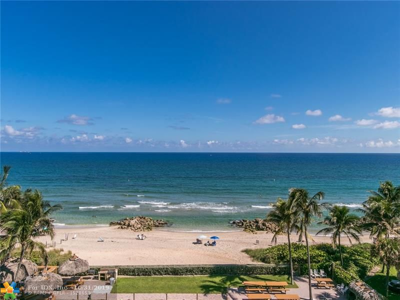 Do you dream of a FLORIDA  OCEAN CONDO with sweeping VIEWS of the BEACH and OCEAN  from all rooms? Do you prefer an airy corner unit with sky and breezes  off the 2 large patios?  Large rooms & closets? How about a secure maintained building with on site management, heated pool & sauna ,fitness, club room, library, extra storage & ample parking? A PRIVATE BEACH PAVILLION with Tiki Huts & BBQ  on the sand? Want to walk to music & dining, shops &  water sports or fishing? ? Just a few blocks stroll to the colorful lively pier area.  This ones for you. Make the call. ** See Broker Remarks.