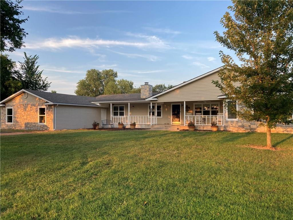 """Come see this spacious 5 BED, 3 BATH home on 7.5 AC corner lot, 1 block from Lake Thunderbird. Loaded w/ extras including whole-house GENERAC nat gas generator with Auto-On design, 2 efficiency-zoned 4-Ton nat gas HVAC units, updated PEX plumbing, FAST OEC Fiber Internet and new heavy-comp. roof. Features include KitchenAid stainless kitchen, with Dual-Fuel Cooktop.  Step into huge 23 X 23 ft main suite with bath including Whirlpool tub. Newer addition includes 2 big bedrooms sharing bath, but each having private vanity and linen cabinets. The Great Room is professionally wired for surround- sound & includes built-ins galore, floor to ceiling rock fireplace and beautiful windows & French doors. Plenty of storage outside, with 2 """"man-cave"""" shops, one 30 X 40, another 24 X 30. First shop wired with 240 and divided into office space and tools/mechanical. 2nd shop (120v) great for boat/ATV/bikes/mowers etc. Sparkling 30 ft POOL (new pump) w/deck, RV carport, 30 X 70 dog pen, & more!!!"""