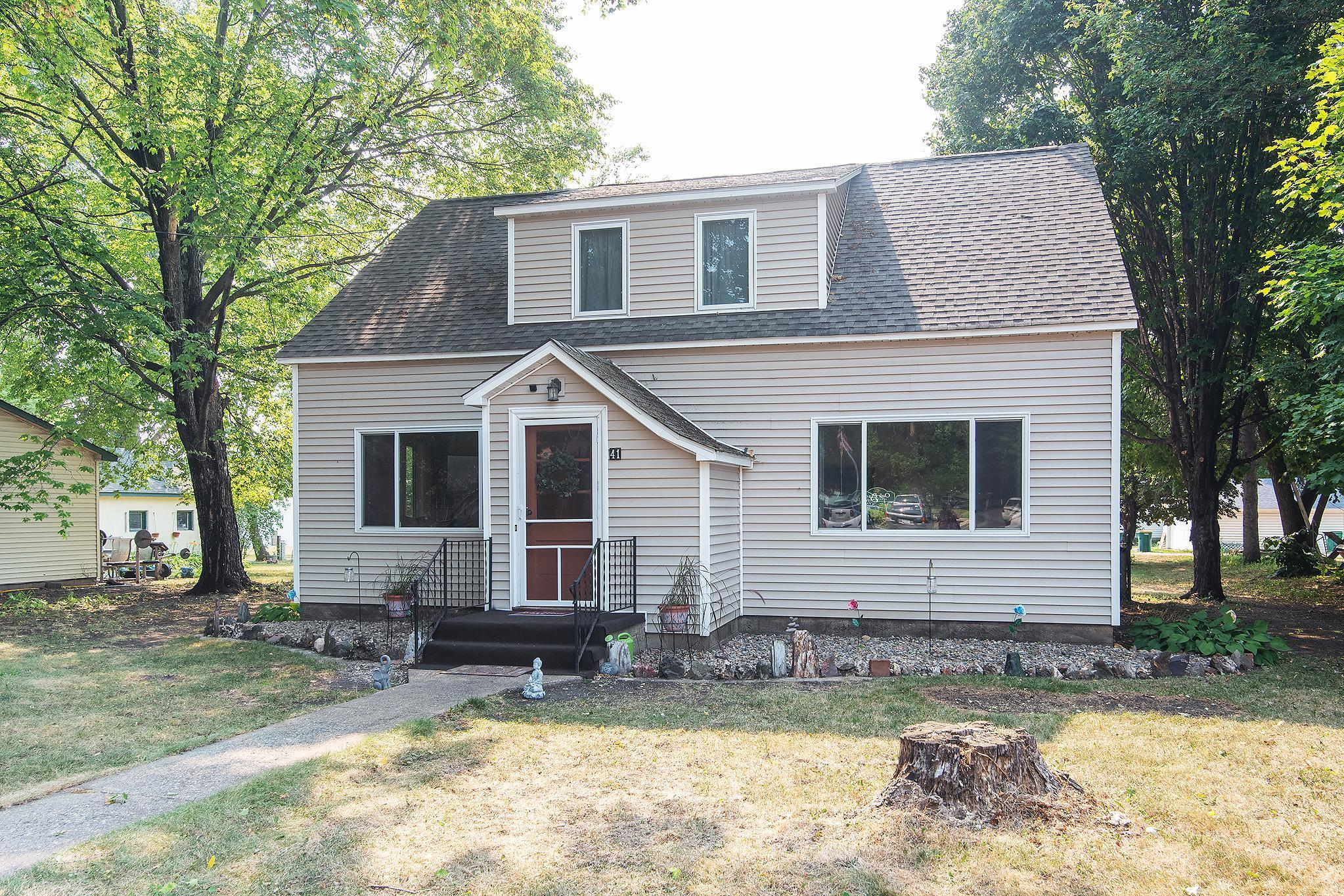 This 1948 One & 1/2 story home is located on a .26 acre city lot with fenced in backyard.  The home features 1970 FSF, 4 bedrooms, 3 bathrooms, detached 2 car garage, office, (future master bedrooms w/walk-in closet, just missing egress window), main floor laundry, hardwood floors, main floor bedroom, 3 bedrooms upstairs, large living room on main level, lower level family room, and large utility room and storage room.  Updates include newer roof, siding, windows, furnace, water heater, water softener and insulation in 2013, landscaped yard, new carpeting in hallway and whole upstairs in 2017, dishwasher and dryer in 2016.  Close to schools, shopping and access to Hwy 15 & 55.