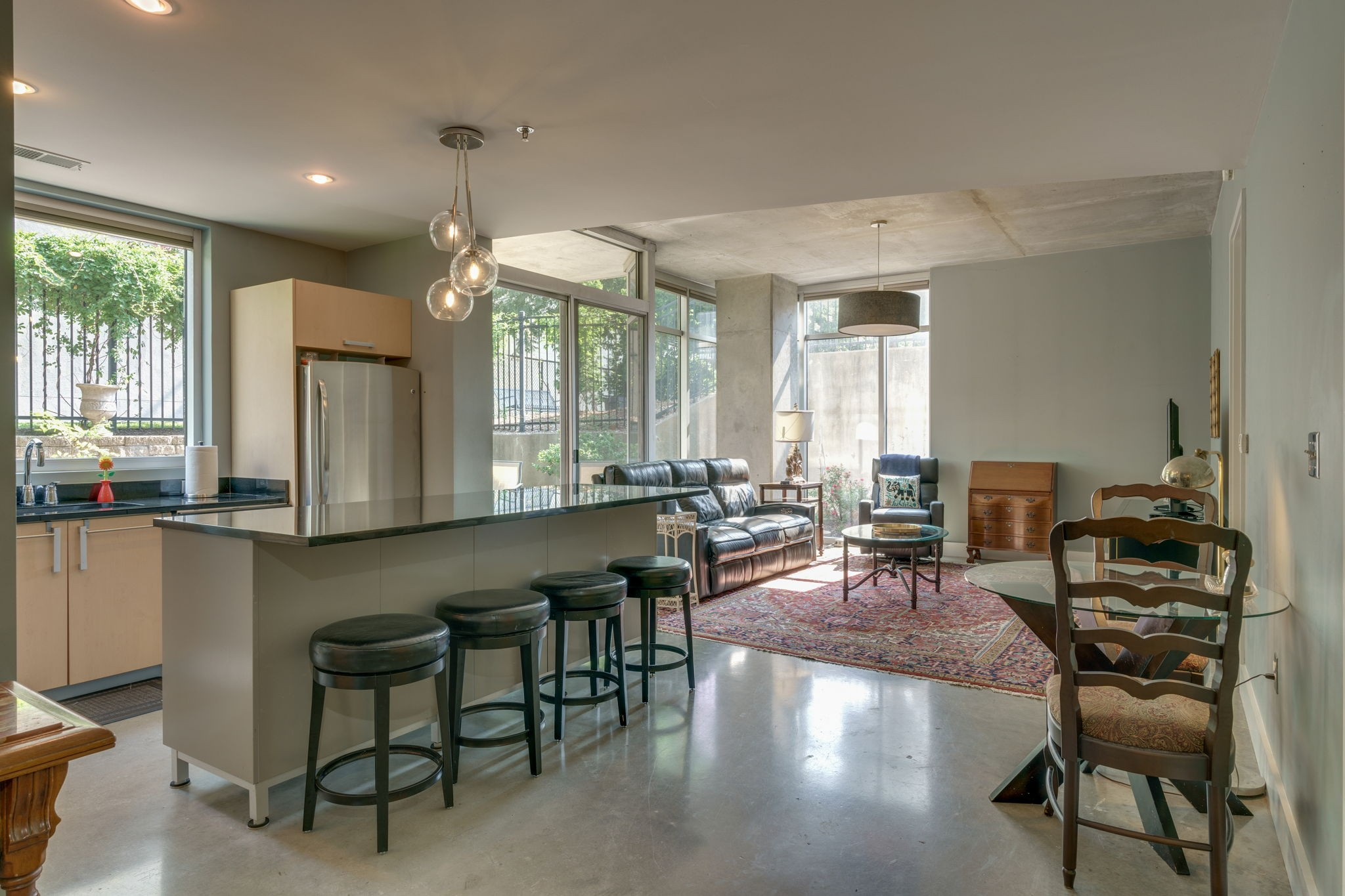 Located in the Heart of the Gulch, This Unique End Unit has 2 Bedrooms/ 2 Baths Plus Den with an Exquisite Patio to Enjoy Outdoor Living w Ample Space to Create a Beautiful Garden. Unit has Concrete Floors, Tile Backsplash, SS Appliances, 2 Prime Parking Spots (360,362) and an Easy Walk to the Unit and Close to the Elevator. Enjoy the Amenities the Icon has to offer: 24 Hr Concierge, 2 Pools, Club Room, Fitness.