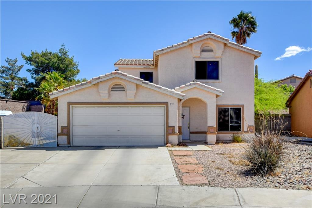 4 berdroom 3 bathroom Henderson home with pool and RV parking. This home features hard wood flooring thorughout the bottom floor, formal living room and dining room, breakfast bar, one bedroom and bathroom downstairs, covered patio, pool and spa.