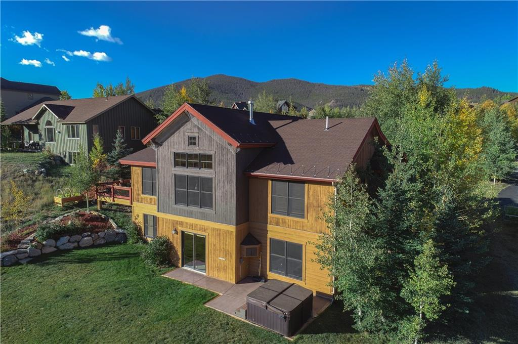 Enjoy magestic views of the CO mtns from this lovely home! Great room, chef's kitchen, master suite, office, laundry, all on the Main. Family room below; walkout to hot tub or play pool, w/wet bar, home gym, 3 more bedrms, extra storage. The lovely, landscaped yard merges into the Soda Ck open space, where the creek flows directly to Lake Dillon. Access miles of hiking/biking. On a quiet cul-de-sac, it's an easy walk to SumCove Elem. Oversize heated 2-car garage completes this perfect home!