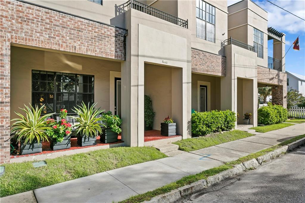 CitiLoft Townhomes mark the border of historic Ybor City and Channelside. Live on a quiet street 2 blocks from a vibrant urban village with shops, restaurants, libations, and frequent host to cultural events and parades. Walk ¼ mile to either Riverwalk or a FREE trolley to Sparkman Wharf, Amalie Arena, Bayshore Blvd. Owner has impeccably maintained this loft style townhouse for its new owner to enjoy! Expansive 12' i-beam ceilings and an open staircase create an industrial lofty feel. So many upgrades including: New TPO roof (2014) All appliances 2019: Bosch Dishwasher, LG refrigerator with see-through door, Samsung Convection Range, Central A/C with heat pump upgrade to LENNOX 16 seer 1-ton compressor with air handler and Wifi HONEYWELL thermostat, AOSMITH Advanced under sink water filter, KOHLER LilyField-Pro pull down kitchen faucet. Remodel of master bathroom to include: VIGO suspended glass shower wall, NEZZA rainshower with waterfall 6-jet shower panel system, crystal/steel/marble tile, floating double vanity with vessel sinks, low flow toilet. The second bedroom has its own balcony overlooking downtown and private upgraded bath. Window film with 3M Night Vision 25: insulated, tinted, hurricane-resistant film (heat reduction 51%, 130mph wind protection) Inviting brick paver front porch and finished rear courtyard. 1 car garage with wifi door opener and extra alley parking. No formal Hoa, no rules, pet or rental restrictions. Owners pay $150.00/mo towards landscaping, trash, and water usage.