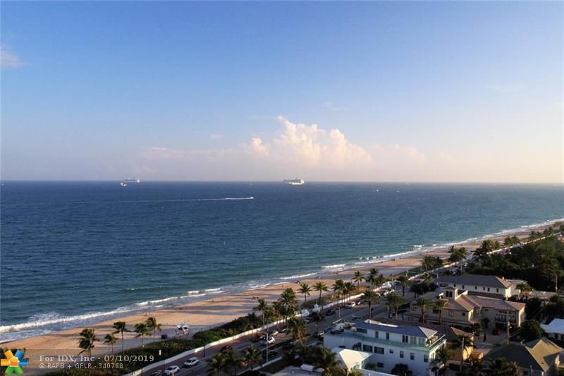 PENTHOUSE WITH MILLION$ VIEWS OF OCEAN, PARK & INTRACOSTAL. ENTER FROM A SEMI PRIVATE ELEVATOR LOBBY INTO A SPACIOUS TWO BEDROOM, TWO BATH. BEAUTIFUL OPEN KITCHEN WITH FULL WRAP AROUND BAR FOR ADDITIONAL SEATING.THE PRIVATE BALCONY IS LIKE AN EXTRA ROOM FOR ENTERTAINING & A LARGE LIVING ROOM W/ SEPARATE FORMAL DINING AREA. THE MASTER BEDROOM HAS WALK-IN CLOSET & EN-SUITE MASTER BATH. THE SECOND BEDROOM BEING USED AS OFFICE & GUEST ROOM. COMPLETING THIS PENTHOUSE IS PORCELAIN TILE THRU OUT LIVING AREA WITH CARPET IN BEDROOMS & A HI-TECH CEILING HAS BEEN INSTALLED IN MOST LIVING AREAS WHICH MAKES CEILING LOOK 20' TALL. WASHER/DRYER IN HOME & NEW A/C & HOT WATER HEATER. GARAGE PARKING & ADDITIONAL STORAGE. ENJOY FIVE STAR BEACHFRONT AMENITIES POOL, CLUBHOUSE, GYM & PRIVATE BEACH ACCESS