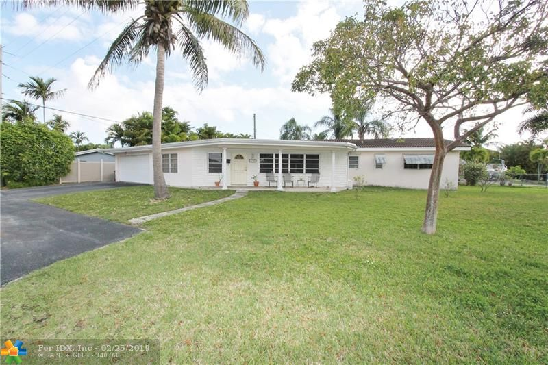 Huge 3/2 home in East Wilton Manors Neighborhood. Almost 2500 Sq/Ft under air with a great layout. This 3/2 home features a large kitchen that flows into the dining room and Florida room, a spacious living room, a bonus Den/Office space, a 2-Car garage, and a separate indoor laundry room.  The lot is just shy of a quarter acre and there is room for a pool on the property. Coral Gardens is in close proximity to restaurants, shopping, Wilton Drive, and the beach.