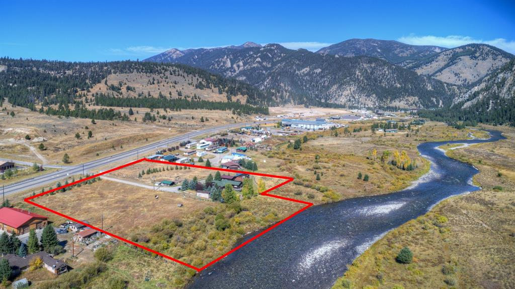 Incredible opportunity on 5.21 acres zoned commercial and industrial mixed use within a mile to the entrance to Big Sky. Versatile use with beautiful views and over 300 feet of Gallatin River frontage. Property boundary goes to center of the Gallatin River. Currently the 3 cabins are occupied and rented. Private well and septic. There are no covenants on the property. Set up for horses presently. Premium Big Sky entry corridor location with prime development potential subject to Gallatin Canyon & Big Sky Zoning Regulations.