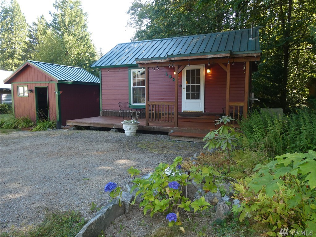 THE BEST OF EASY LIVING ~ Exceptional home base in Skykomish! Featuring newer kitchen/bath/flooring/paint/ plumbing/windows/foundation and more ~ EVERYTHING'S DONE! Move-in and enjoy now. 13K install on generator for peace of mind in winter months. 3 outbuildings and workspace 12sq w/concrete floor n power, 7.5sq storage + 3rd wood or yard equipment. This is a double lot (development opportunity). 30 AMP~RV ready. Minutes away from biking~hiking~whitewater~fishing and 15 minutes to skiing!