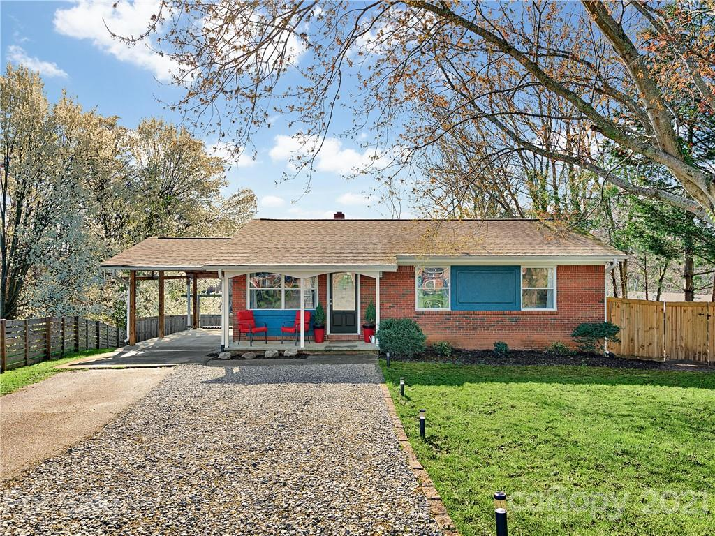 Location, location, location!  This 1969 ranch sits on a beautiful, .25 acre lot on a quiet cul-de-sac, while only half a mile from the heart of hip West Asheville (restaurants, bars, & shops) and half a mile from Carrier Park (dog park, multi-sport facilities, & walking trails along the French Broad River). With 3 bedrooms and 1 bathroom, this cozy home offers lots of charm and potential for making it your own. The back deck overlooks a spacious and well groomed fenced-in backyard that is perfect for pets or the avid gardener. The sunny, south-facing yard comes complete with mature fruit trees and a view. Plenty of parking options available with a main driveway, carport and a separate side street driveway, ideal for parking a boat or RV! Exterior is freshly painted, newer HVAC and roof, and brand new hot water heater - Move in ready! Must see this gem!
