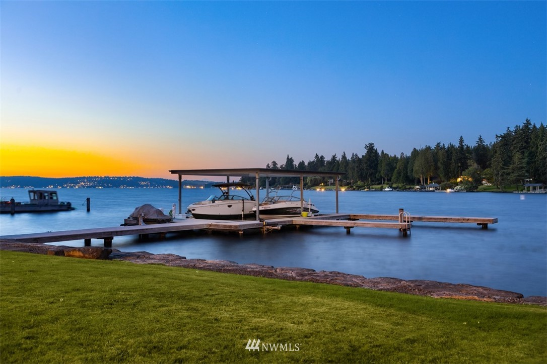 Clean lines frame sweeping views of Lake Washington from this luxurious Medina Modern on Fairweather Bay. Awash in sleek finishes & refined details, this home makes a dramatic statement. 80 ft of waterfront with lush lawn & dock. Floor-to-ceiling windows, a fabulous floor plan & expansive outdoor living set the stage for intimate gatherings & grand galas, including a huge chef's kitchen w/stunning views. Work-from-home areas are balanced with a swim spa, sauna & media/rec rooms w/kitchenettes.